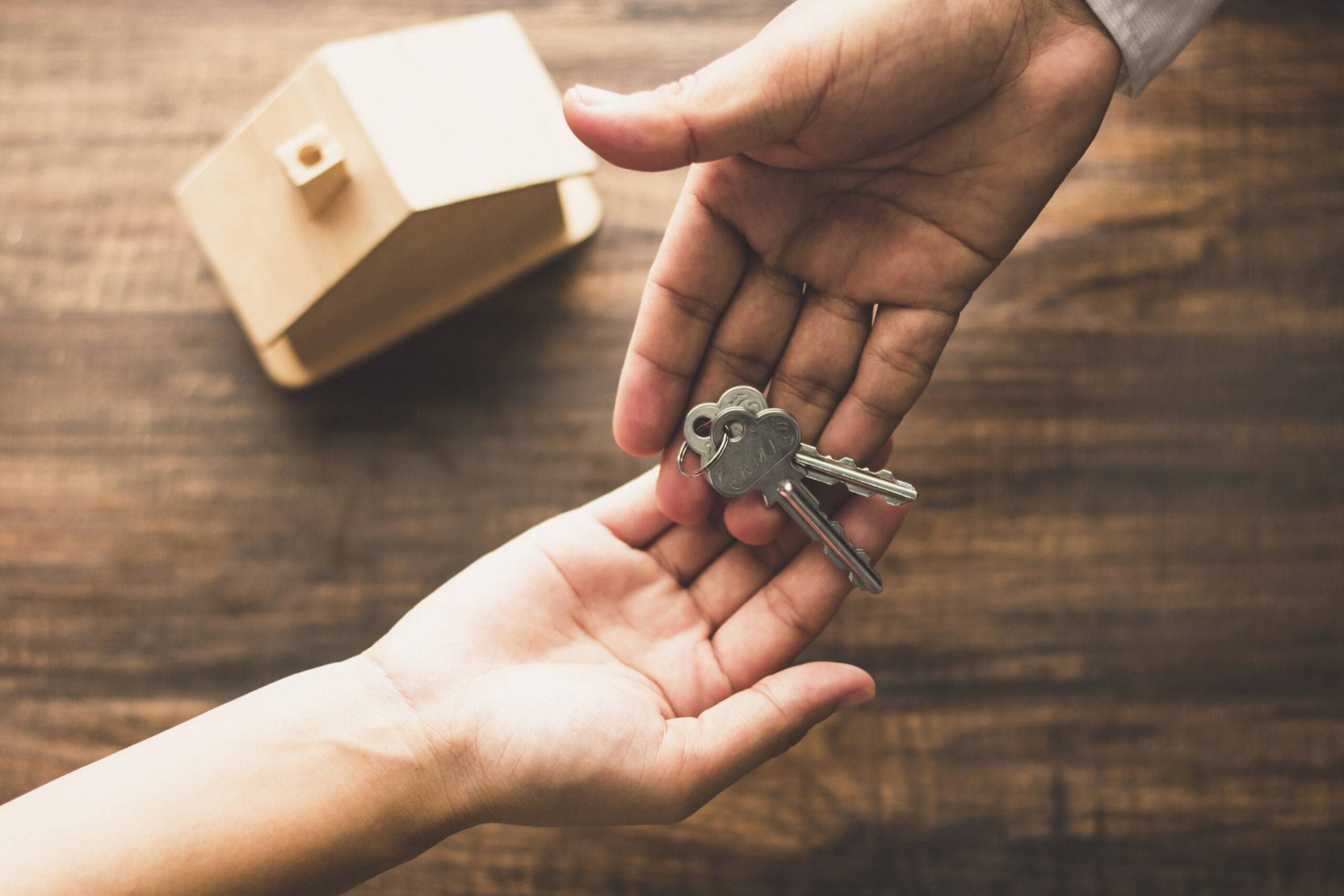 Real estate concept,top view of banker agency give house key to buyer or client
